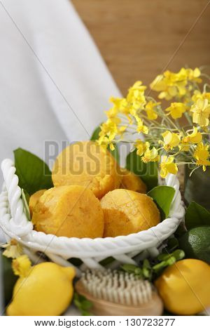 Handmade Natural Yellow Round Citrus Scented Soap in a Basket. Product Photography. Still Life.