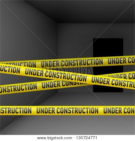 Dark room with yellow Under construction danger tape