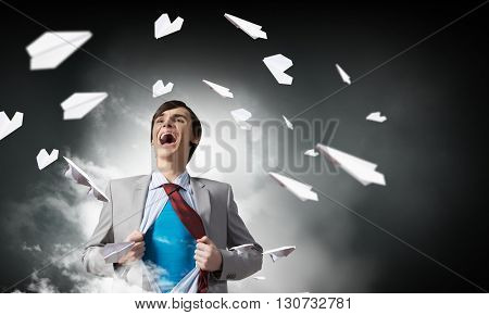 Screaming emotionally super businessman