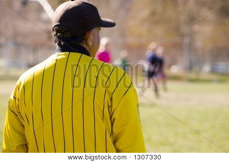 Soccer Official Watching Game