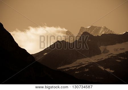 Schreckhorn, Swiss Alps - snow capped mountains and deep valleys stunning view breath-taking panorama