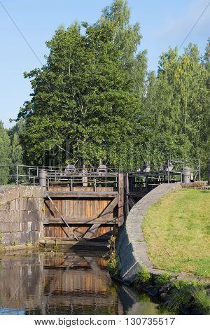 Ancient wooden gate of the old lock