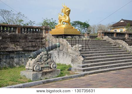 HUE, VIETNAM - JANUARY 07, 2016: Golden dragon on the terrace of the Imperial Forbidden Purple city. Historic landmark of the city Hue, Vietnam