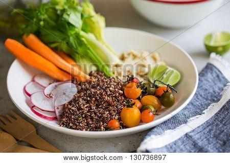 Quinoa with fresh celerycarrot and hummus salad