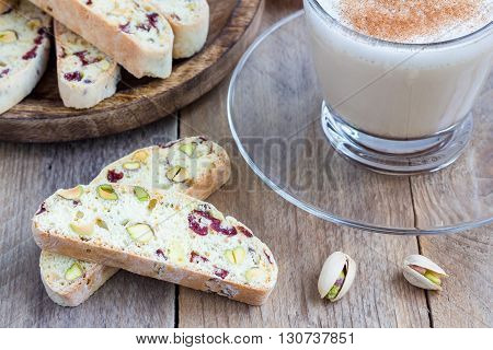 Biscotti with cranberry and pistachio, with cup of coffee latte