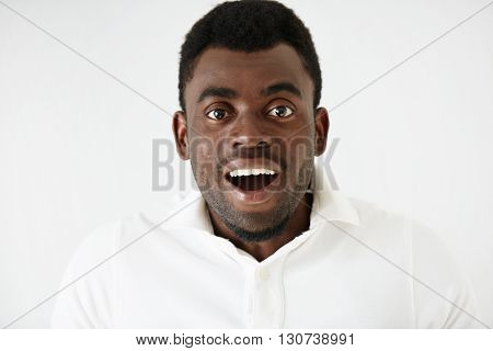Closeup Portrait Of Happy Young Handsome African American Man Looking Excited And Stunned With Mouth