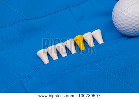 Detail of blue trousers and golf equipments