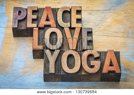 peace, love and yoga word abstract - text in vintage letterpress wood type printing blocks