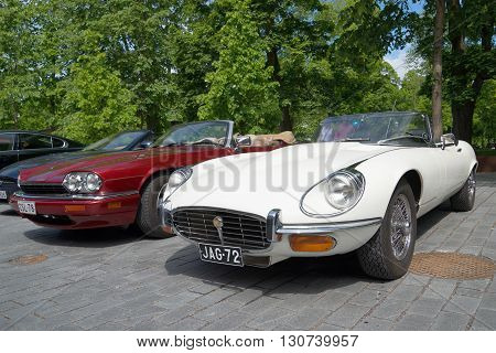 TURKU, FINLAND - JUNE 13, 2015: White Jaguar E XKE Series 3 and red Jaguar XJ-S (XJS) on the parade car brand