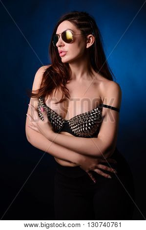 Young Woman In The Top With Studs