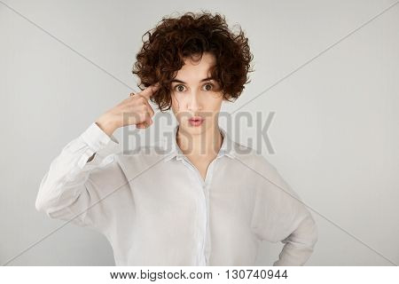 Close Up Portrait Of Mad Or Disappointed Young Businesswoman Making A Gesture With Her Finger Agains