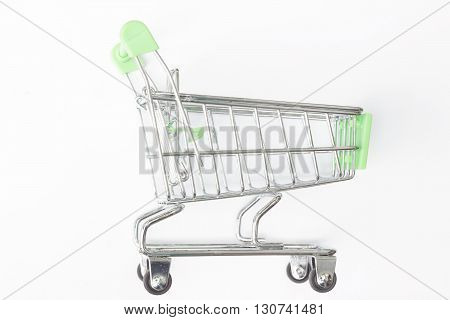 Empty metal shopping cart on isolated background.