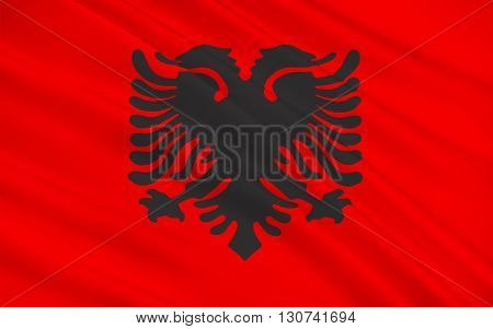 The Flag of Albania is a red flag with a silhouetted black double-headed eagle in the center that represents the sovereign state of Albania located in the Balkans