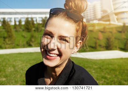 Headshot Of Happy Pretty Teenage Girl With Bun Hairstyle Looking And Smiling At The Camera, Enjoying