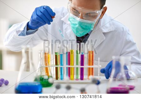 scientist work research and analyses content of test tubes- chemistry and research concept