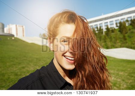 People And Lifestyle Concept. Headshot Of Attractive Young Caucasian Student Girl With Long Loose Re