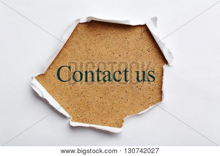 Torn white paper for text close up, contact us