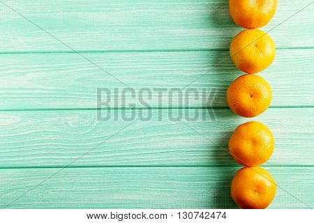 Ripe Mandarins On A Mint Wooden Table