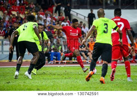 July 24, 2015- Shah Alam, Malaysia: Liverpool's Jordan Ibe (red) shoots at goal in a friendly match against the Malaysian Team. Liverpool Football Club from England is on an Asia tour.