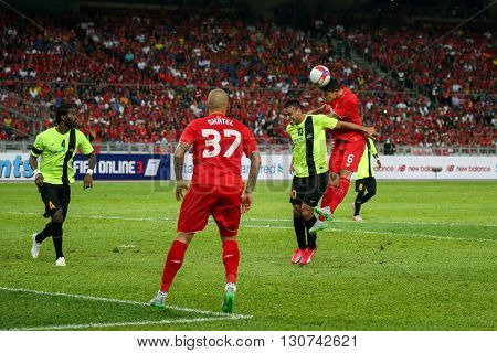 July 24, 2015- Shah Alam, Malaysia: Liverpool's Martin Skrtel (37) watches Dejan Lovren (6) heads the ball in the friendly match against Malaysia. Liverpool from England is on an Asia tour.