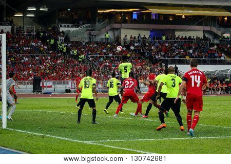 July 24, 2015- Shah Alam, Malaysia: Malaysia's goalkeeper Khairul Azhan and defenders (green) defends the ball in a friendly match against Liverpool. Liverpool FC from England is on an Asia tour.