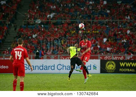 July 24, 2015- Shah Alam, Malaysia: Liverpool's Dejan Lovren (6) heads past Kumaahran (12) in a friendly match against the Malaysian Team. Liverpool Football Club from England is on an Asia tour.