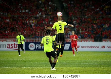 July 24, 2015- Shah Alam, Malaysia: Malaysia's defender Thiago (3) heads the ball in a friendly match against Liverpool FC. Liverpool Football Club from England is on an Asia tour.