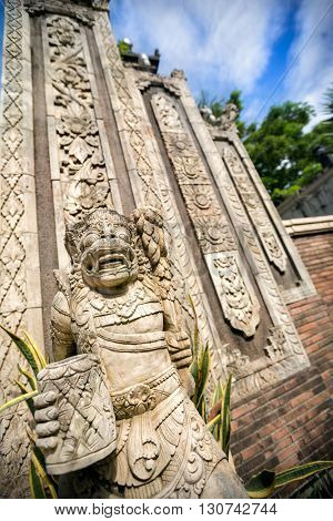 Statues and carvings depicting demons, gods and Balinese mythological deities in Ubud, Bali.