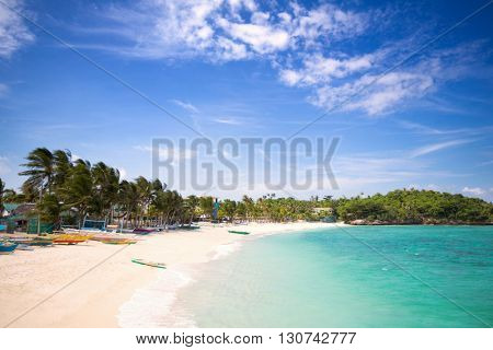 Tropical beach with clear emerald water and white sand