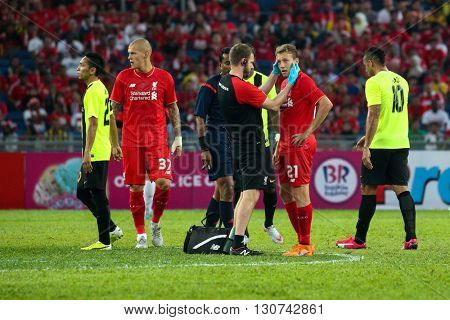 July 24, 2015- Shah Alam, Malaysia: Liverpool's physiotherapist checks injured Lucas Leiva (21) during the friendly match against Malaysia. Liverpool Football Club from England is on an Asia tour.