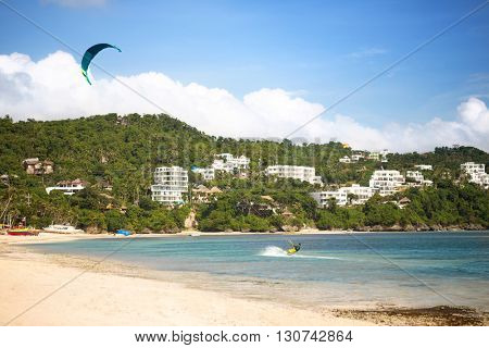 kite surfer surfing on beautiful exotic bay