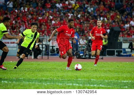 July 24, 2015- Shah Alam, Malaysia: Liverpool's Jordan Ibe (3) dribbles the ball in a friendly match against the Malaysian Team. Liverpool Football Club from England is on an Asia tour.