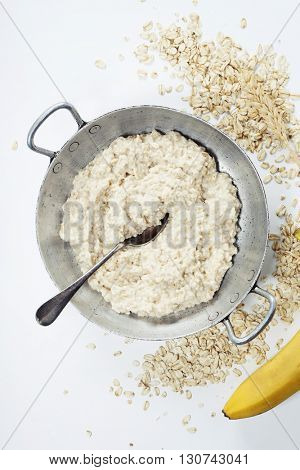 Bowl of Homemade Healthy oatmeal porridge with banana -  diet food