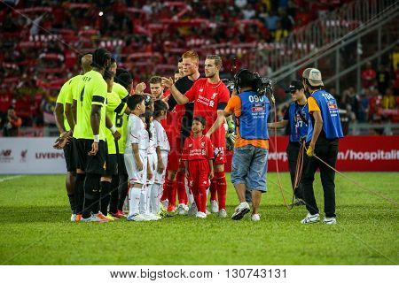 July 24, 2015- Shah Alam, Malaysia: Liverpool players (red) meets Malaysian players (green) before the start of their friendly game. Liverpool Football Club from England is on an Asia tour.