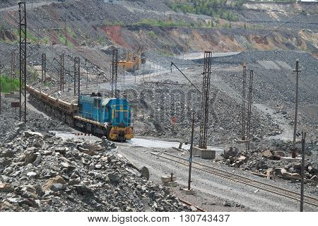 Cargo train carrying iron ore from the opencast mining