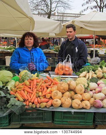 Woman Is Selling Vegetables On The Street Market In Ljubljana, Slovenia