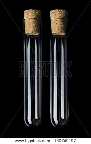 Two empty glass transparent test tube closed with cork on black background vertical