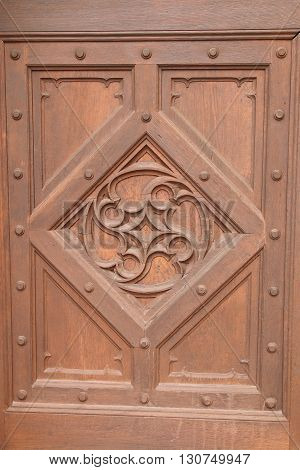 Pictured elaborately carved pattern on the wooden door. From a long time wood has a crack.