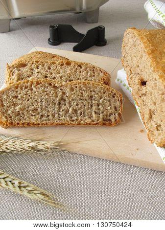 Bread from bread making machine on cutting board
