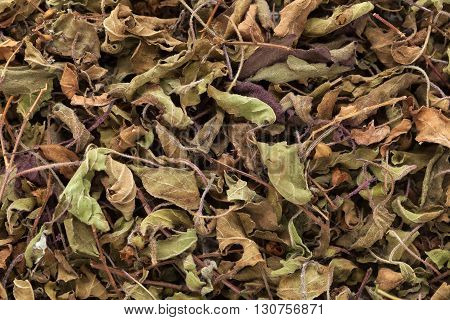 Organic Black Basil or Krishna Tulsi (Ocimum Tenuiflorum) dried leaves. Macro close up background texture. Top view.