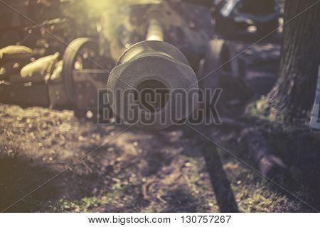 close up on cannon, sunset or sunrise