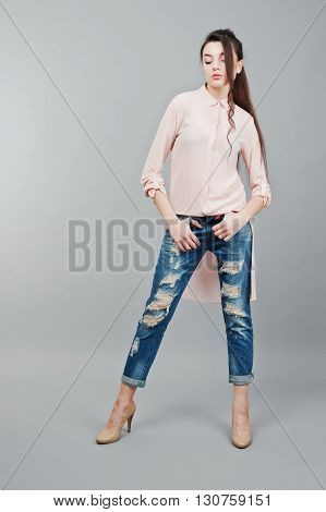 Full-length Portrait Young Brunette Girl Wearing In Pink Blouse, Ripped Jeans And Cream Shoes .fashi