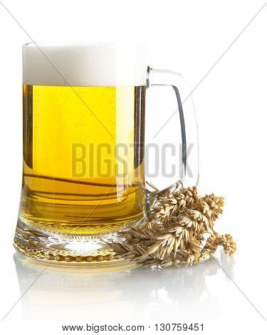 Pint Of Beer On Table With Ears Of Wheat Isolated On White