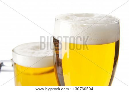 Closeup Cropped Mugs Of Beer With Foam Isolated On White