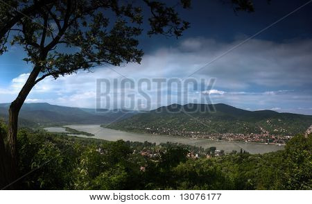 This is a landscape with river in the valley. The location is the bend of Danube in Hungary during a the most higher flood in the past 100 years.
