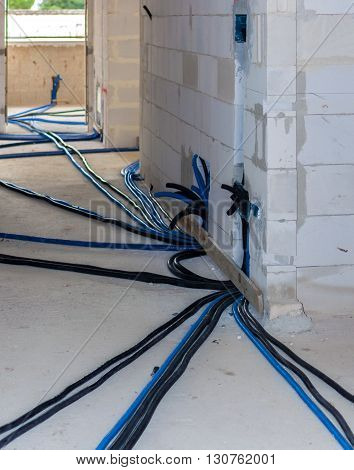 Pipes and heating system at house construction site. floor heating system the collector and tools