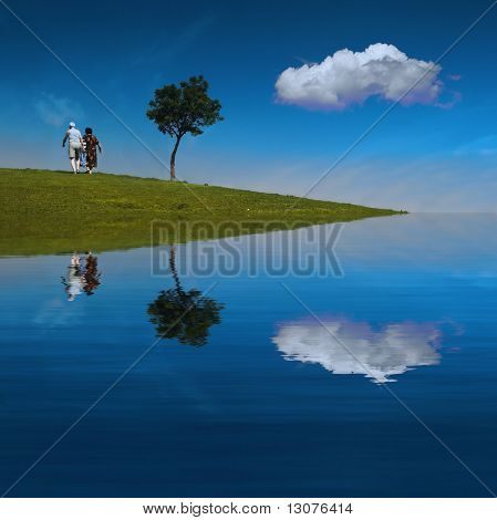 Old couple walk in an idyllic scene.