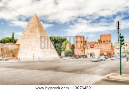 Defocused Background With Pyramid Of Cestius In Rome, Italy