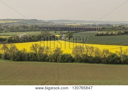 An image of the impressive Harringworth viaduct shot on a hazy morning at Seaton, Rutland UK
