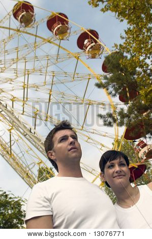 Young couple is posing in the Theme Park.